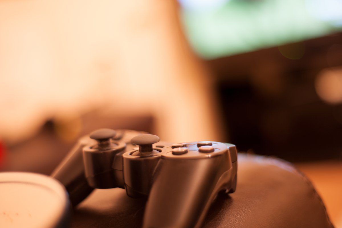 video game controller on couch